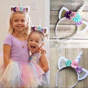 🦄Silver tone unicorn headband. New in package.